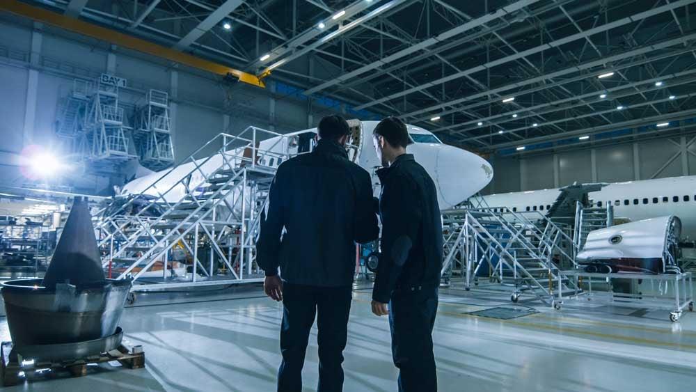 men-in-hangar-discussing-IoT-challenges-in-aviation