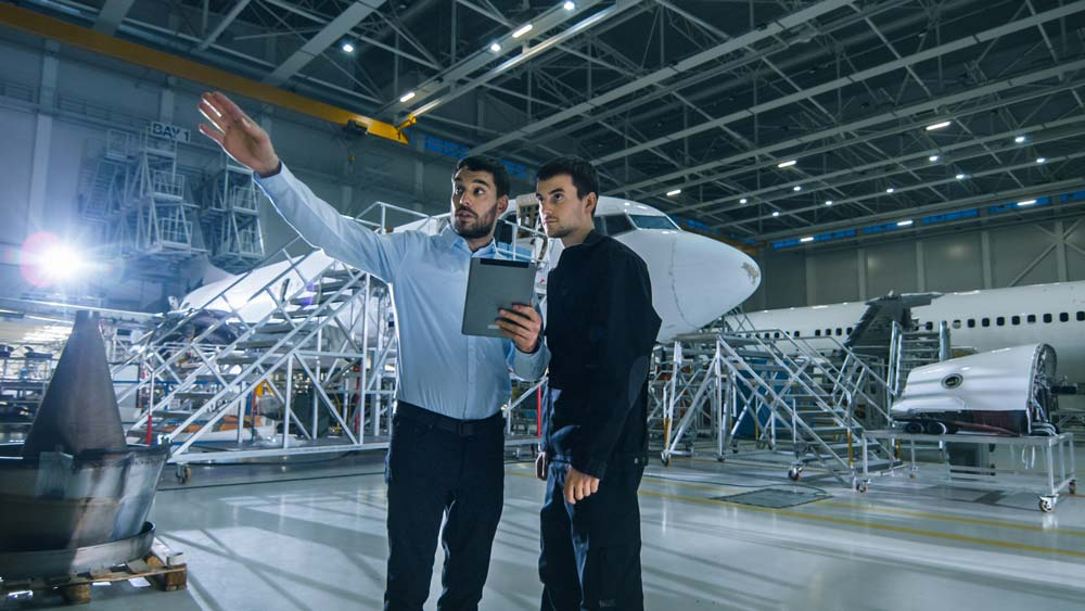 Businessman and aerospace engineer discussing how to foster innovation in an organisation.