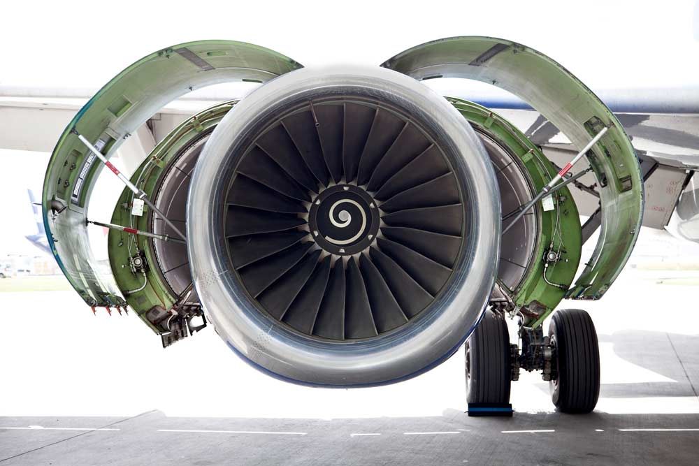 The next generation of aircraft engines installed on a parked airplane in the airport.